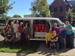 Members of Highlands United Methodist Church in Denver pose with cleaning buckets they prepared for those affected by the Colorado floods. A UMNS photo by the Rev. Bradley Laurvick.