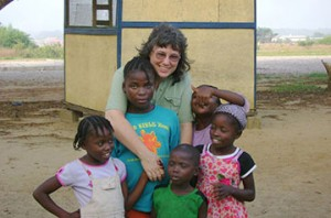The Rev. Kathy Crozier poses with children at Bishop Judith Craig Children's Village in Duahzon, Liberia. Crozier, who contracted malaria during a 2008 mission trip to Liberia, and her husband Jim helped raise more than $323,000 to help fight the disease. A UMNS photo courtesy of Kathy Crozier.