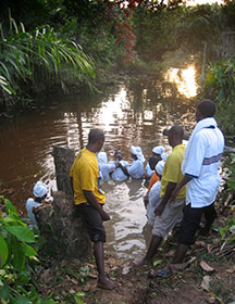 """A new Christian is baptized in Salala, Liberia, in 2010. """"As the church grows, it reaches people in remote areas who are most vulnerable to malaria,"""" says the Rev. Roger Ross, pastor of First United Methodist Church in Springfield, Ill. A UMNS photo by Roger Ross."""