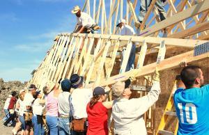 Volunteers Building a Building