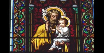 Detail of stained glass window of St. Joseph and Jesus from Church Sainte Marguerite in Le Vesinet in the Departement Yvelines, Ile-de-France.