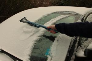 Brushing Snow from Car