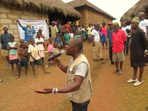 The Rev. Michael Gbenday gives an educational program about Ebola in Mende, the local language of the people of Moyollo village in Sierra Leone.