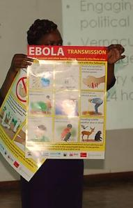 The Rev. Pauline Njiru of Kenya displays a poster showing how Ebola can be transmitted.