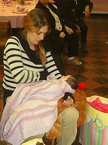 Newborn Lacey catches a little nap during her Baby Shower at Central Church.