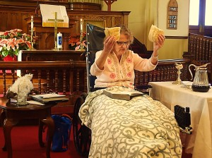 "Following her serious automobile accident and several surgeries, Pastor Jan celebrates communion from her wheelchair.  See the full article on our ""Food for Thought"" page!"